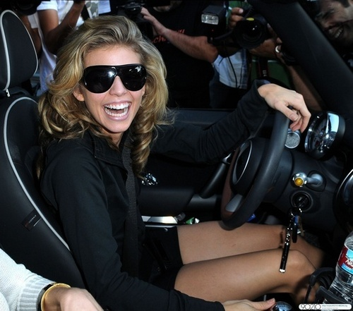 AnnaLynne drives through Beverly Hills in her Mini Cooper