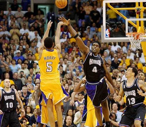 Los Angeles Lakers wallpaper with a basketball player and a basketball called Robert Horry's game-winner vs. Kings