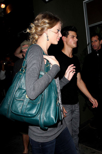 Taylor Lautner and Taylor Swift wallpaper probably containing a pantleg and long trousers titled Taylor & Taylor Date Night
