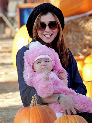 Alyson Hannigan wallpaper possibly with sunglasses and a pumpkin titled Alyson Hannigan and Her Baby Bunny!