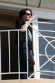 Kristen Stewart takes smoking break during New Moon junket today - twilight-series photo