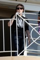 Kristen Stewart takes smoking break during New Moon junket today - twilight-series photo