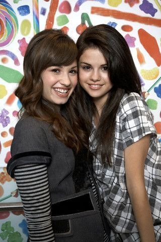 selena gomez dan demi lovato wallpaper possibly containing a well dressed person and a sign titled Selena Gomez and Demi Lovato