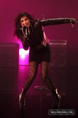 Demi Lovato wallpaper probably containing bare legs, hosiery, and a hip boot entitled demi lovato Remember December