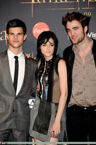 Twilight Series wallpaper possibly with a business suit titled  Pictures From Madrid Event With Robert Pattinson, Kristen Stewart, Taylor Lautner