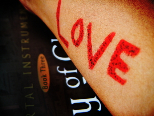 To Write l'amour On Her Arms.
