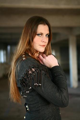 Symphonic Metal 壁紙 possibly containing a hip boot, a well dressed person, and a legging titled Floor Jansen