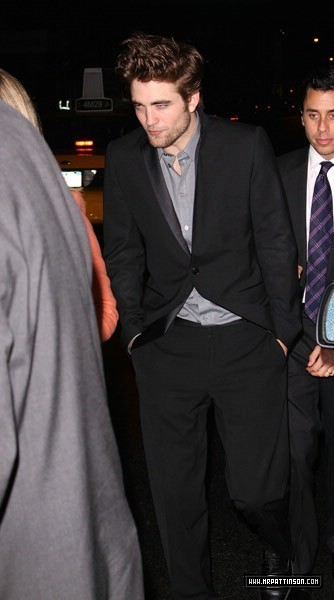 New Pics: Rob wears a suit AND a hat. Leaving NYC Screening