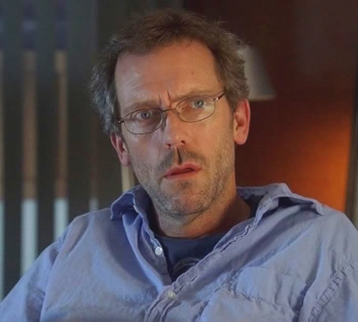 Hugh Laurie with glass...