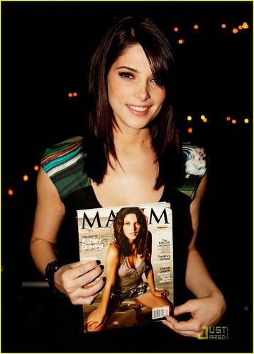Ashley cebrates her December 2009 issue of Maxim