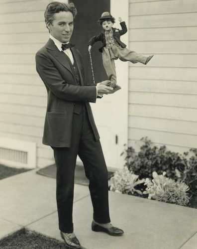 Charlie with Doll - charlie-chaplin Photo