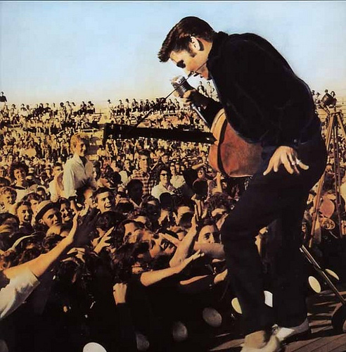 http://images2.fanpop.com/image/photos/9200000/Elvis-on-stage-in-Tupelo-Mississippi-1956-elvis-presley-9205074-492-500.jpg