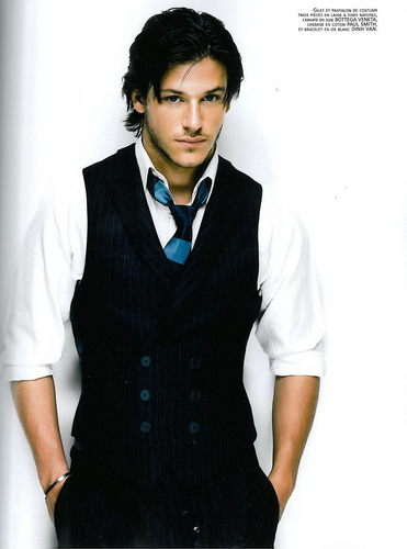 Masquerade wallpaper probably with a well dressed person and a business suit called Gaspard Ulliel