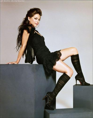 Masquerade wallpaper containing a hip boot, a well dressed person, and tights entitled Kristin Kreuk
