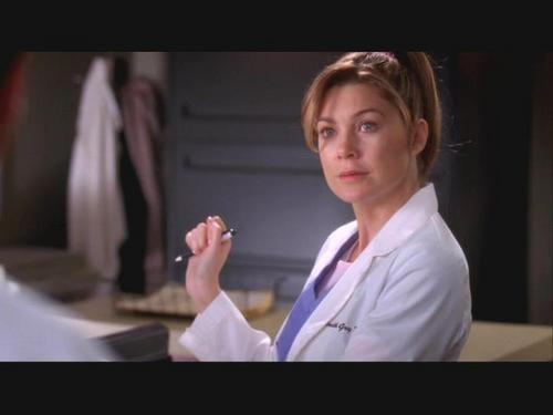 Meredith with a ponytail.