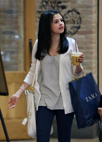 Selena Gomez wallpaper containing long trousers, a well dressed person, and an outerwear called Selena Gomez Shopping At Zara