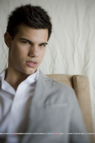 Taylor/Jacob Fan Girls wallpaper containing a business suit titled Taylor Lautner Photoshoot - L.A Times