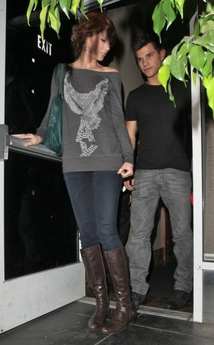 Taylor Lautner and Taylor Swift wallpaper probably containing a hip boot, a revolving door, and a sign entitled Taylors