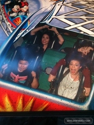 Demi Lovato wallpaper with anime called demi at disney land with her family