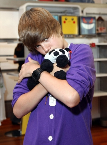 Justin Bieber with a stuffed panda!!!!