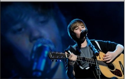 Justin Bieber wallpaper containing a guitarist, a concert, and an acoustic guitar entitled Justin at the Jingle Ball in MN