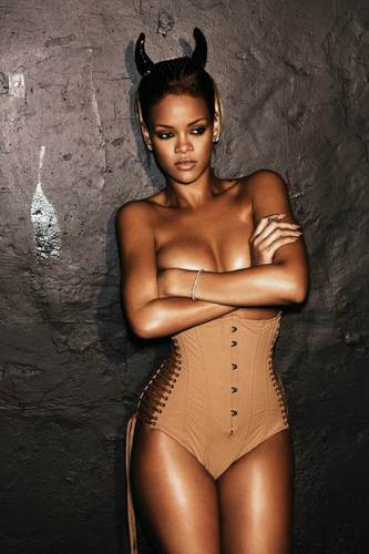 Rihanna wallpaper probably containing skin entitled Rihanna Rated R Promo Photos