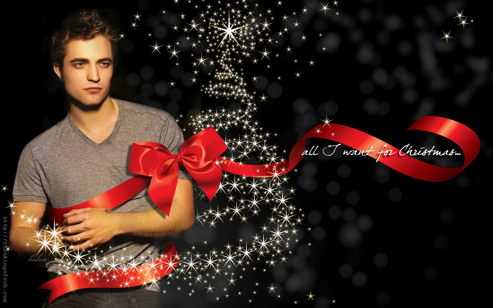 http://images2.fanpop.com/image/photos/9300000/Robert-Pattinson-Wallpaper-twilight-series-9333929-1680-1050.jpg