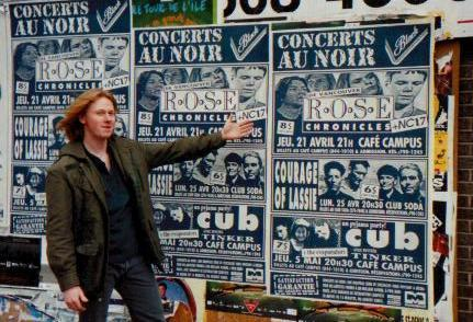 Steve pointing to poster