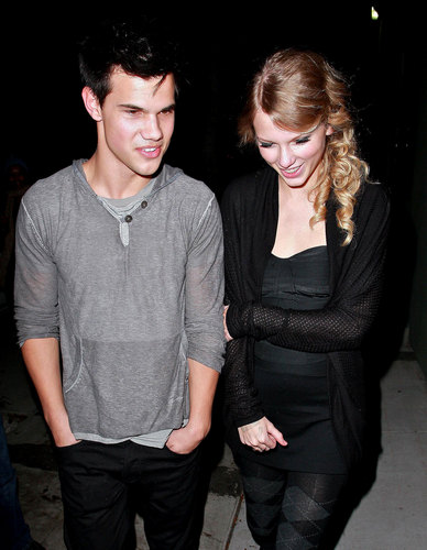 Taylor Lautner and Taylor Swift wallpaper possibly with a well dressed person, sunglasses, and a pantleg titled Taylor & Taylor Reunite on 'Valentine's Day'
