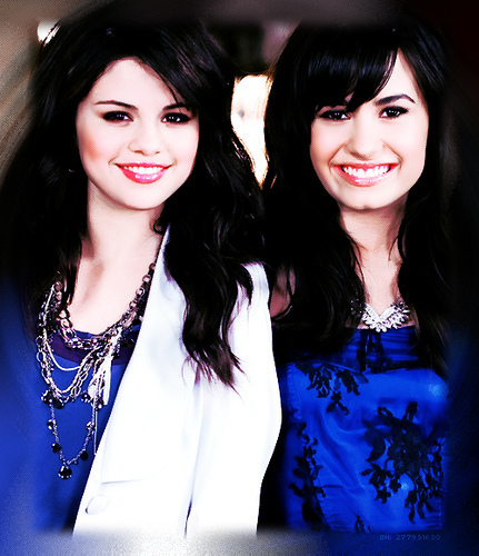 Selena Gomez wallpaper possibly with a portrait entitled demi lovato and selena gomez