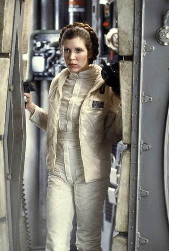 Princess Leia Organa Solo Skywalker wallpaper possibly containing an outerwear, a well dressed person, and a hip boot entitled leia