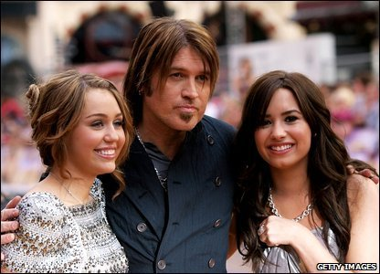 miley, her dad and demi