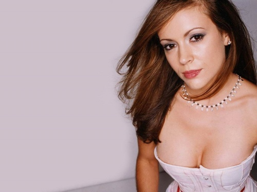 Alyssa Milano wallpaper probably with attractiveness, a chemise, and a portrait called Alyssa Milano