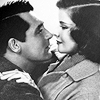 Cary Grant photo probably containing a green beret titled Cary Grant and Katharine Hepburn