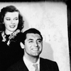 Cary Grant photo with a business suit, a suit, and a well dressed person entitled Cary Grant and Katharine Hepburn