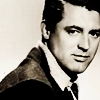 Cary Grant photo probably with a business suit, a well dressed person, and a portrait called Cary Grant