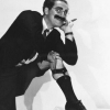Marx Brothers photo probably containing a well dressed person and a business suit entitled Groucho