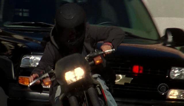 SUV Chasing Motor Cycle