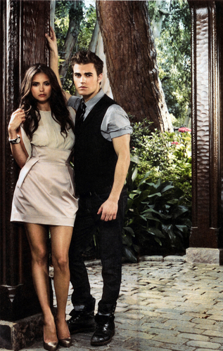 Paul Wesley and Nina Dobrev wallpaper probably containing bare legs, a hip boot, and a street called Paul and Nina