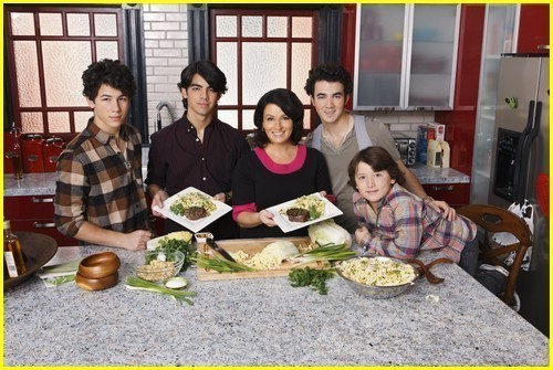 The Jonas Brothers wallpaper containing a dinner, a dinner table, and a holiday dinner entitled Jonas