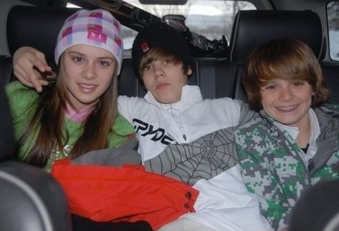 Justin with friend and family