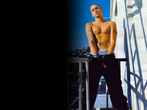Eminem Hintergrund with a hunk, a six pack, and swimming trunks entitled Eminem