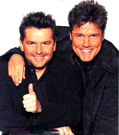 Modern Talking achtergrond possibly containing a well dressed person, a business suit, and a suit called Modern Talking