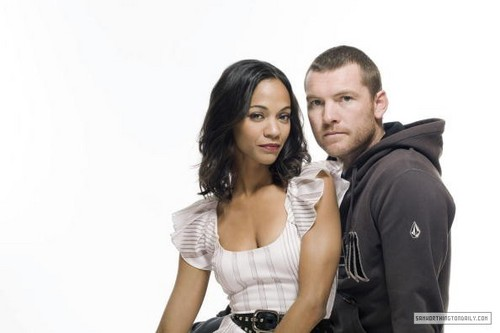 Sam Worthington hình nền possibly containing a hip boot and a portrait titled Sam Worthington & Zoe Saldana