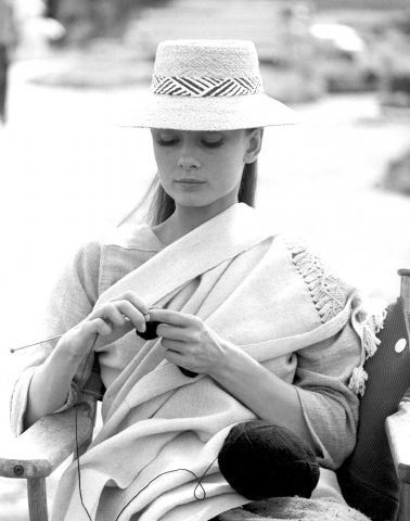 Audrey knitting on the set of The Unforgiven. -1960