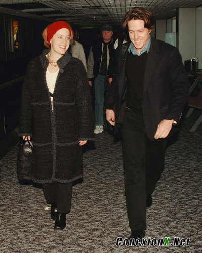 Gillian with Hugh Grant at Heathrow Airport, london February 13, 1999