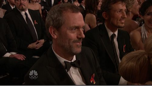 Lisa laughing with Hugh at the GG's 2010