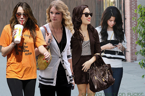 Miley & Taylor VS Selena & Demi wallpaper called demi miley selena taylor