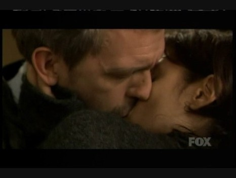 Which episode, house kisses Cuddy?