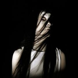 In what movie does the spirit of Kayako Saeki stalk and kill people who enter her house?